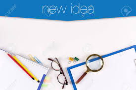 idea office supplies. High Angle View Of Various Office Supplies On Desk With A Word New Idea Stock Photo
