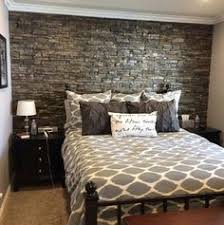 Absolutely love all the gray tones and that stone headboard wall! My  brother in law has his own construction company in SoCal and never ceases  to ...