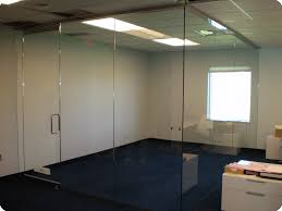 polish stainless shoe top and bottom smart glass electrified glass doors in conference room changes from clear to opaque with a flip of a switch