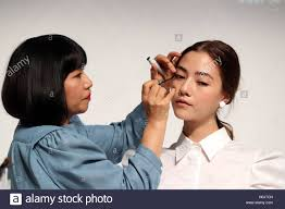 tokyo an 21st sep 2016 an s cosmetics giant shiseido chief professional make up artist miyako okamoto l gives a make up to a model as the