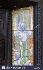 art nouveau fireplace tiles with iris pattern