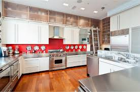 floor to ceiling white kitchen cabinet with frosted glass door kitchen wall cabinet and red backsplash also stainless steel countertop match with stainless