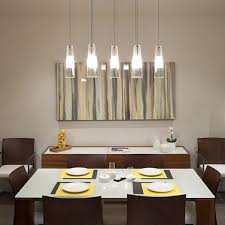 multi pendant justice design lighting above small white dining table and six wooden chairs also small abstract painting