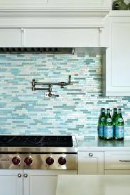 white kitchen cabinets with blue glass backsplash cobalt