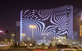 the lighting intensity and colour effects are digitally controlled and cographed adding another layer of fluidity to the building s skin