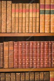 old books on wooden shelves in library education concept photo by microgen