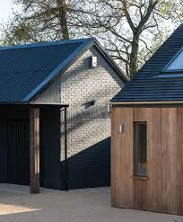 painted brick and timber cladding at the stables mclean quinlan bespoke brickwork garage office