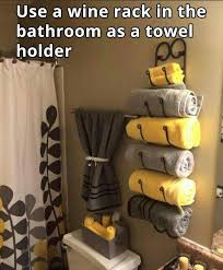 Small Picture Awesome idea to use a wine rack as a towel rack in the bathroom