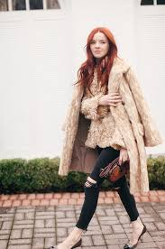 we see light brown long fur coat styled with a pretty fuzzy tweed blazer knee ripped black skinnies and sti color blocking pumps