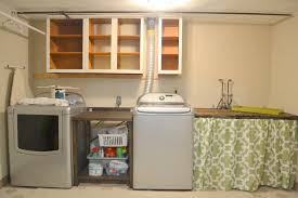 unfinished basement laundry room makeover. Unfinished Laundry Room Makeover Design With Custom Table Storage Between  Washer And Dryer Plus Wood Wall Mounted Cabinet Black Metal Hanging Rod Unfinished Basement Laundry Room Makeover