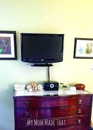 hiding cords on carpet hanging your television to the wall how hide electrical cords on hide