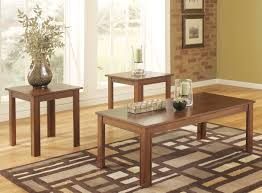 ashley furniture yoshi piece coffee table set signature design by mahogany tables s glass round