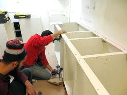 replace kitchen sink cabinet installing drain with disposal plumbing dishwasher cabinets