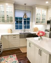 think beyond regular door fronts and add glass to some of your cabinets interior cabinet lighting adds ambiance and showcases glass cabinets beautifully