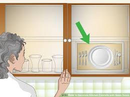 image titled decorate kitchen cabinets with glass doors step 1