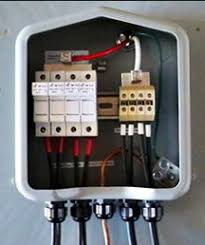step by step guide to installing a solar photovoltaic system notice four sets of wires positive and negative entering at the bottom and marked tape red for ungrounded conductors