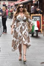 The elegant dress had a square neckline and puffed sleeves. Kelly Brook In Summer Dress 07 15 2019 Celebmafia