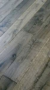 the fantastic aged gray on this oak flooring is really lovely going for that calm timeless french country look