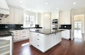 white kitchen cabinets with black countertops kitchen with white cabinets and black granite with wood flooring white kitchen cabinets black countertops