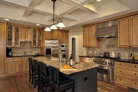 contemporary kitchen installed on wooden flooring and equipped with kitchen exhaust fan and granite countertop