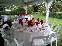 66 round guest table with white linens white resin chairs and jpg