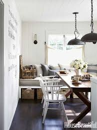 use a banquette for extra seating at the dinner table and as an extra guest bed designed by erin martin and kim dempster housebeautiful dining room