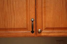 image of kitchen cabinet knobs with cupboard door handles backplate
