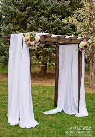 romantic wedding ceremony wedding arch fabric colorado wedding florist