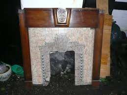 tiled art deco fireplace and wood surround