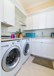teal area rug beach house perdido pensacola large beach style galley laundry room idea in beach style laundry room
