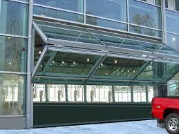 folding garage doorsNice Folding Glass Garage Doors with Schweiss Designer Doors