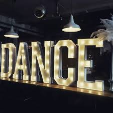 new illuminated letters available for hire from words to glow our dance illuminated letters look great elevated on a stage