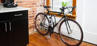 Bike hanger for apartment Indoor Bike Clug Bike Storage Rack Is Storing Black Bike Inside Tiny Kitchen Makespace Clug The Perfect Bike Storage Rack For Your Tiny Apartment
