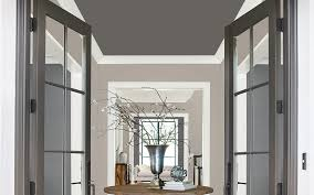 an entryway ceiling is painted dark grey to accent beige walls