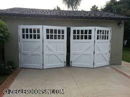 bi fold garage doorsCarriage Garage Door in a Bi Fold configuration East Side Costa