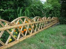 vegetables garden fence ideas for protection. Excellent Home Garden Design Featuring Yellow Orange Flowers Protected With Custom Bamboo Fence Vegetables Ideas For Protection