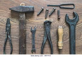 metal awl tool. different tools (pliers, hammer, awl, wrench, nippers, chisel) on metal awl tool