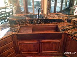 this is a 48 signature series copper farmhouse sink with a waterstone 5500 faucet soap dispenser and air switch