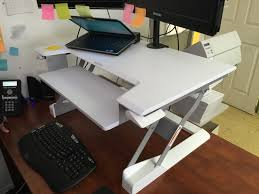 transform your regular desk into a healthier standing one with this sy add on