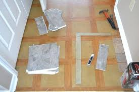 removing old stick on floor tiles how to remove ceramic tile adhesive from wood self herringbone l n grace gumption home improvement excellent her