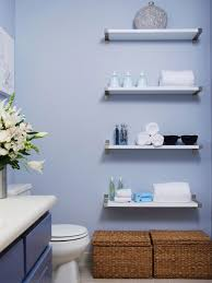 floating white wooden shelves with four shelves for bathing utensils