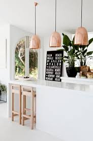 kitchen in the home of designer marika jarv with stanley hammered copper pendant lights by original btc
