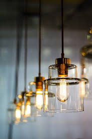 glowing traditional light bulbs in a row of pendant lights
