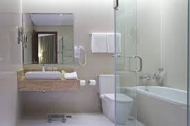 acacia hotel manila muntinlupa deluxe room 1 king bed bathtub guest