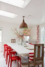 super cool red and white dining room distinctive red chairs and a white table pair beautifully with a crisp white room with statement ds and lighting