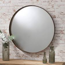 round metal industrial style wall mirror in bronze finish