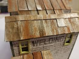 i love making metal roofs and adding metal siding to my structures the metal roof when applied right painted well and weathered to look like an old rusty