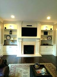 cabinets next to fireplace. Built Ins Around Fireplace Ideas Bookshelves With Cabinets Next To