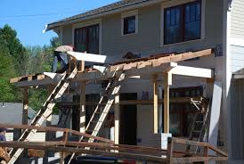 once the ridge beam was in place then we worked on how the rafters sit on the beam and form the gable over the front steps and porch