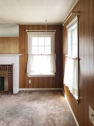 see this dated wood paneled living room